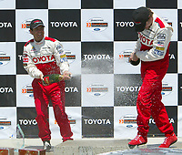 Apr 12, 2003; Long Beach, CA, USA; Pro Category Winner JEREMY McGRATH with overall race winner PETER RECKELL splash eachother with Champaigne @ the 27th Annual Pro/Celebrity Race in Long Beach racing Toyota Celica race cars.  Driving 10 laps on a 1.97 mile track along shoreline drive. <br />