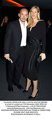 Footballer GIANLUCA VIALLI and his wife CATHERINE, at a ball in London on 11th December 2003.PPN 145