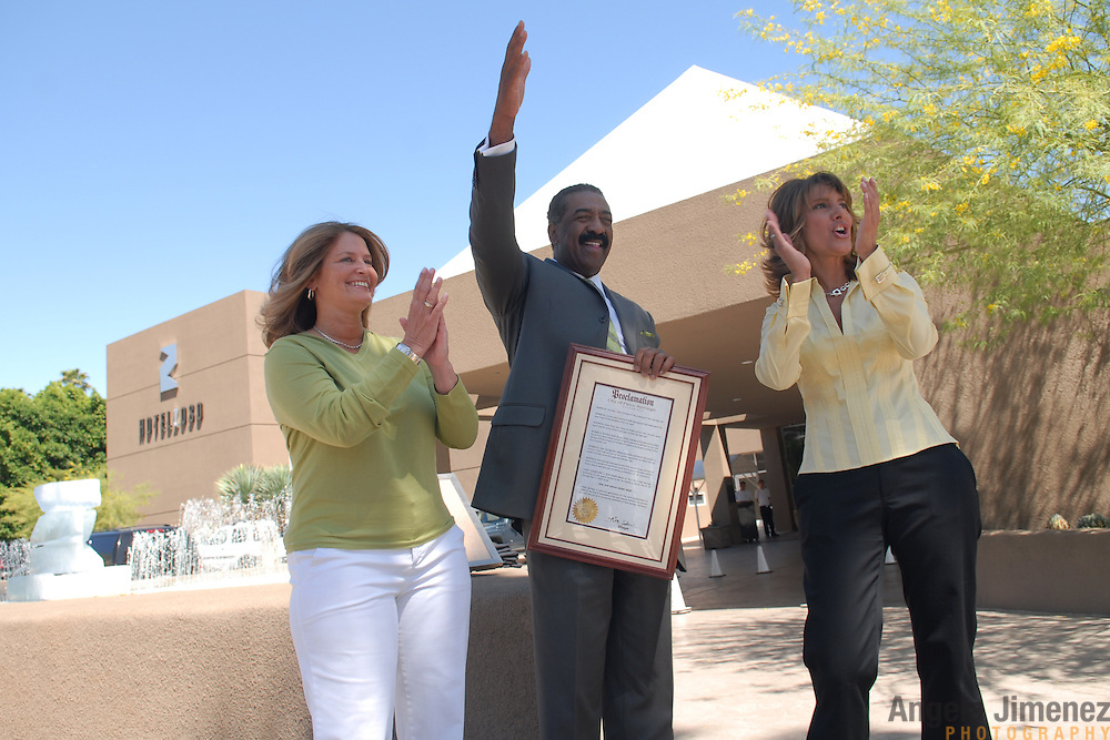"Lesbian party promoters Robin Gans, left, and Sandy Sachs, right, receive a proclamation from Ron Oden, center, the mayor of Palm Springs, California, declaring March 28 through April 1, 2007 ""Girl Bar Dinah Shore Week"" during a press conference in front of Hotel Zoso in Palm Springs on March 29, 2007. ..The women's company, Girlbar, runs five days of parties during the Dinah Shore weekend, an annual lesbian gathering run simultaneously with the Kraft Nabisco Championship LPGA golf tournament. Hotel Zoso is Girlbar's ""VIP"" headquarters during the events. ..The mayor issues a similar proclamation each year to Club Skirts, the rival lesbian circuit party which is held at the same time. ""The split has been good for the city,"" the Mayor said of the division of one lesbian party circuit into two. ""It's doubled the event."".."