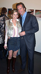 BROOKE DE OCAMPO and CHRISTOPHER GETTY at an exhibition of photographs by Matthew Mellon entitled Famous Feet - featuring well known people wearing shoes from Harrys of London, held at Hamiltons Gallery, Carlos Place, London on 22nd November 2004.<br /><br />NON EXCLUSIVE - WORLD RIGHTS