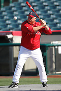 ANAHEIM, CA - APRIL  23:  Team manager Mike Scioscia #14 of the Los Angeles Angels of Anaheim hits ground balls during batting practice before the game between the Boston Red Sox and the Los Angeles Angels of Anaheim on Saturday, April 23, 2011 at Angel Stadium in Anaheim, California. The Red Sox won the game in a 5-0 shutout. (Photo by Paul Spinelli/MLB Photos via Getty Images) *** Local Caption *** Mike Scioscia