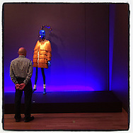 2016 OCTOBER 22 - A man looks at a mannequin in fashion by Yves St Laurent at an exhibition at the Seattle Art Museum in Seattle, WA, USA. Taken with Apple iPhone using Instagram App. By Richard Walker