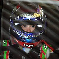 Driver Danica Patrick is seen through her windshield during the first practice session of the 56th Annual NASCAR Coke Zero400 race at Daytona International Speedway on Thursday, July 3, 2014 in Daytona Beach, Florida.  (AP Photo/Alex Menendez)
