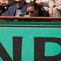 5 June 2009: Eva Parker Longoria takes a picture during the Men's Singles Semi Final match on day thirteen of the French Open at Roland Garros in Paris, France.