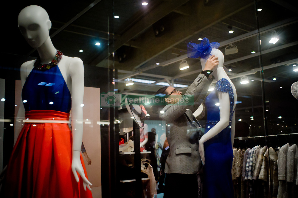 April 28, 2017 - Barcelona, Catalonia, Spain - A woman fixes the hat of a mannequin during the opening day of the  Bridal Week Professional Trade Fair in Barcelona. (Credit Image: © Jordi Boixareu via ZUMA Wire)
