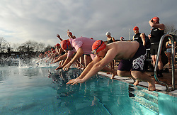 © Licensed to London News Pictures. 08/12/20112. London, United Kingdom. Swimmers take to the water at the Outdoor swimming society (OSS) December Dip at Parliament Hill lido, Hampstead.  This years is the 6th annual Outdoor Swimming Society's December Dip with the water temperature somewhere between 0.1 and 6 degrees. Photo credit : Justin Setterfield/LNP