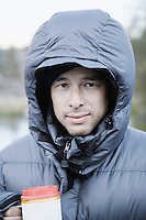Young man of mixed ethnicity in hooded jacket.