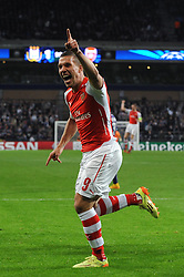 Arsenal's Lukas Podolski scores his winning goal in the last minute of the game - Photo mandatory by-line: Dougie Allward/JMP - Mobile: 07966 386802 - 22/10/2014 - SPORT - Football - Anderlecht - Constant Vanden Stockstadion - R.S.C. Anderlecht v Arsenal - UEFA Champions League - Group D