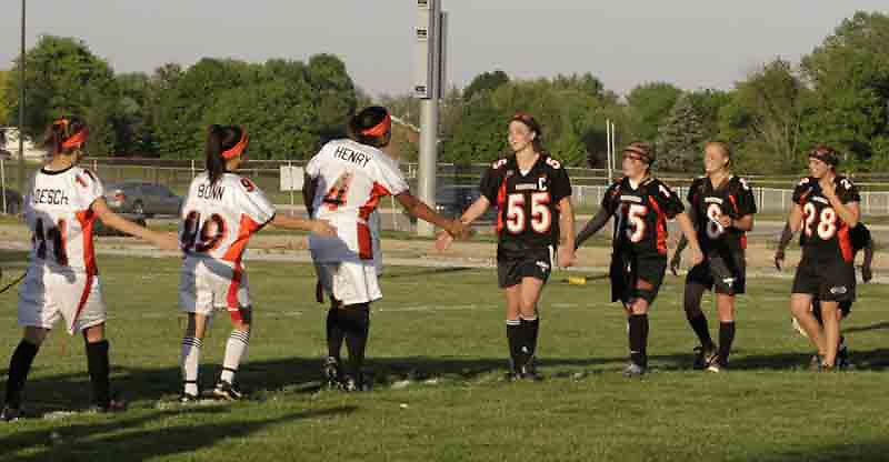 Junior Anaka Davis (4) shakes hands with senior Niki Kuhlman (55) after the 3rd Annual Powderpuff Challenge, the junior girls (class of 2008) against the senior girls (class of 2007.)  The seniors won 14-0.