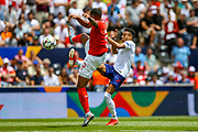 England midfielder Jesse Lingard (Manchester United) puts the ball past Switzerland defender Manuel Akanji (5) during the UEFA Nations League 3rd place play-off match between Switzerland and England at Estadio D. Afonso Henriques, Guimaraes, Portugal on 9 June 2019.