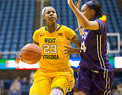 West Virginia Mountaineers guard Bria Holmes (23) tries to make room to shoot against the TCU Horned Frogs at the WVU Coliseum.