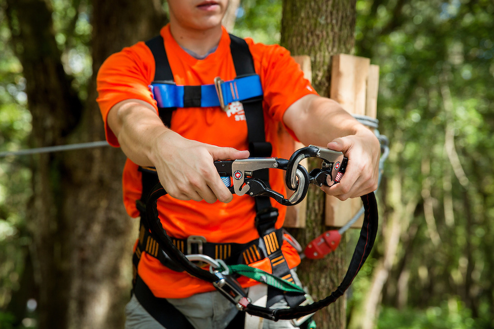 Safety is first at TreeHoppers Aerial Adventure Park as member of their staff demonstrates the proper way to use their climbing gear on September 20, 2015 in Dade City. VISIT FLORIDA/Scott Audette