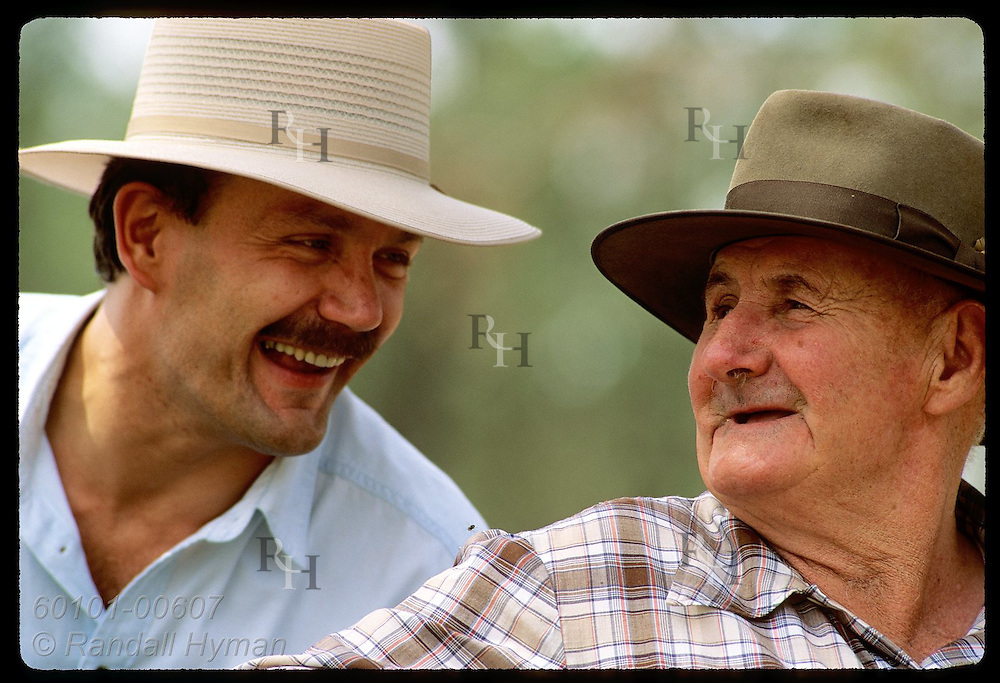 Farmer Jack Veitch (right) & Yugoslavian immigrant Zel Bodulovic swap jokes; Coolamon, NSW. Australia