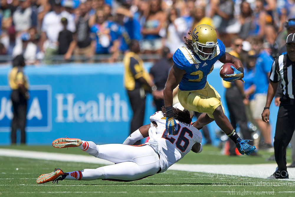 PASADENA, CA - SEPTEMBER 05:  Running back Paul Perkins #24 of the UCLA Bruins is tackled by cornerback Maurice Canady #26 of the Virginia Cavaliers during the first quarter at the Rose Bowl on September 5, 2015 in Pasadena, California. The UCLA Bruins defeated the Virginia Cavaliers 34-16. (Photo by Jason O. Watson/Getty Images) *** Local Caption *** Paul Perkins; Maurice Canady