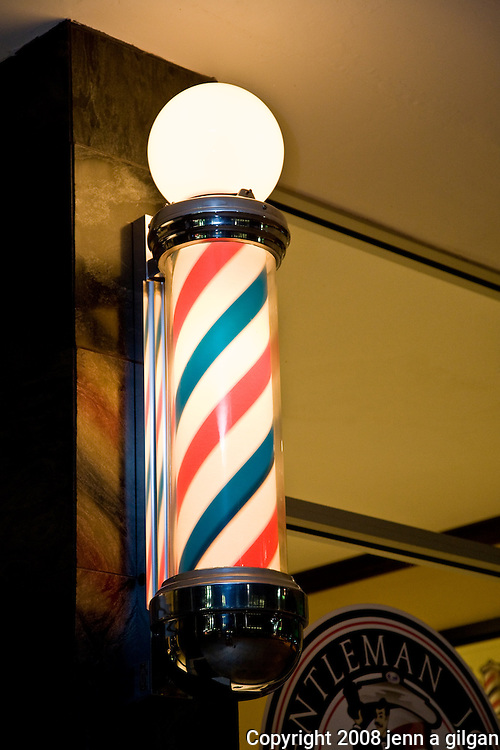 Barber pole outside barber and shoe polish stand, phoenix az
