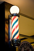 Barber pole outside barber and shoe polish stand, phoenix az