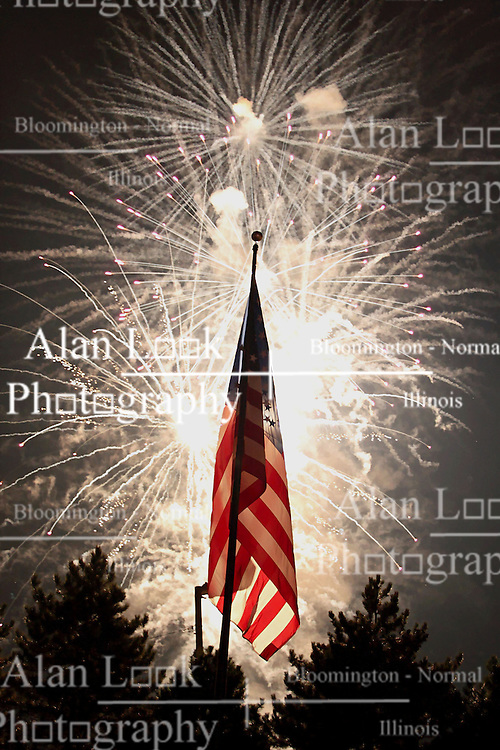 26 September 2009: Fireworks light up the sky and the American Flag during the half-time celebration in a game which the South Dakota State Jackrabitts jump past the Illinois State Redbirds 38 - 17 at Hancock Stadium on campus of Illinois State University in Normal Illinois