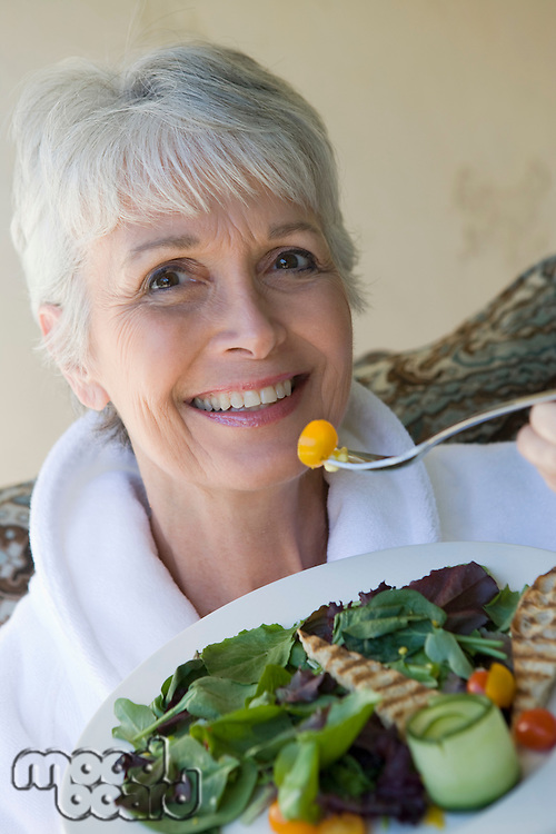 Portrait of senior woman eating healthily