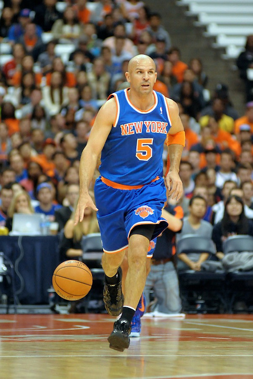 New York Knicks guard JASON KIDD (5) brings the ball up court during the first quarter against the Philadelphia 76ers at the Carrier Dome in Syracuse, NY. Philadelphia defeated New York 98-90.