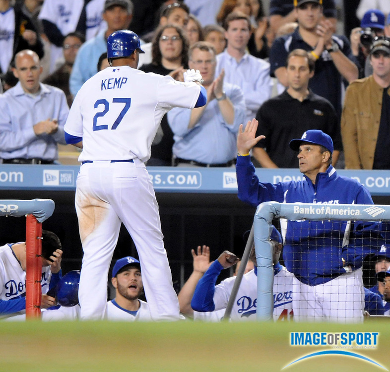 June 2, 2008; Los Angeles, CA, USA; Los Angeles Dodgers center fielder Matt Kemp (27), right, is congratulated by manager Joe Torre after hitting a solo home run in the seventh inning against the Colorado Rockies at Dodger Stadium.