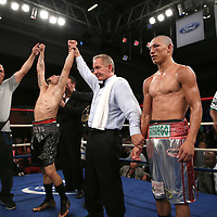 "Jonathan ""Polvo"" Oquendo (black shorts) celebrates after defeating Guillermo ""El Borrego"" Avila for the WBO Latin Featherweight title during the ""Boxeo Telemundo"" boxing match between at the Kissimmee Civic Center on Friday, March 14, 2014 in Kissimmme, Florida.  Oquendo won the fight by unanimous decision. (AP Photo/Alex Menendez)"