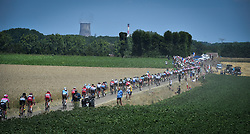 July 15, 2018 - Amiens Metropole, FRANCE - Illustration picture shows the pack of riders in action during the eighth stage of the 105th edition of the Tour de France cycling race, from Arras Citadelle to Roubaix (156,5 km), in France, Sunday 15 July 2018. This year's Tour de France takes place from July 7th to July 29th. BELGA PHOTO DAVID STOCKMAN (Credit Image: © David Stockman/Belga via ZUMA Press)