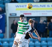 26th December 2017, Dens Park, Dundee, Scotland; Scottish Premier League football, Dundee versus Celtic; Celtic's Michael Johnston competes in the air with Dundee's Mark O'Hara