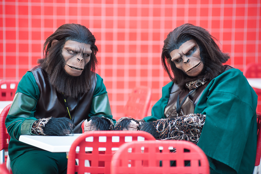 London, UK - 15 March 2014: two people dressed with apes costumes sits at a table at the London Super Comic Con at Excel.