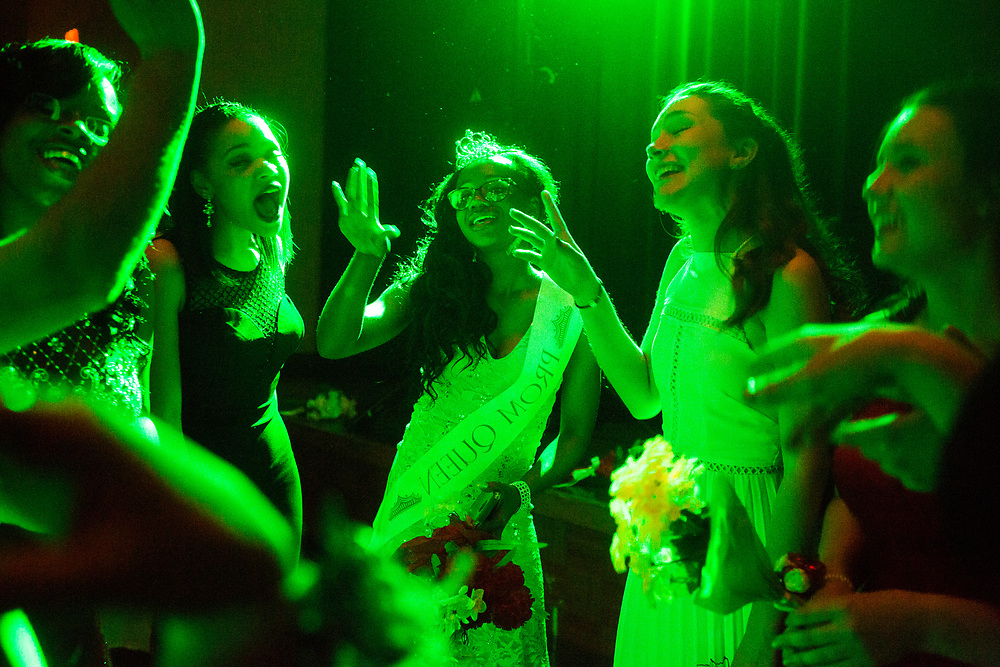 City High Middle School senior Alexis Lowe, 18, dances with friends after being named prom queen Saturday, May 14, 2016, at Aquinas College in Grand Rapids, Mich.