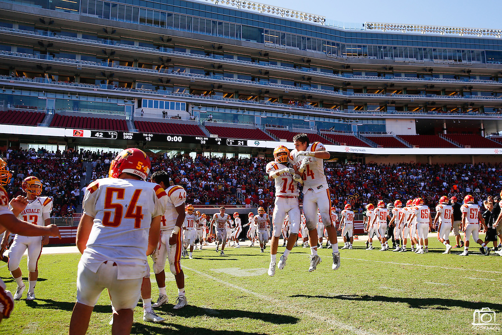 Oakdale wide receiver Logan Hall (14) and defensive lineman Wyatt Hjelm (34) celebrate their 42-21 win over Manteca during Friday Night Lights at Levi's Stadium in Santa Clara, California, on October 11, 2014. (Stan Olszewski/ Special to The Record)