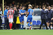 AFC Wimbledon defender Jon Meades (3) coming on for AFC Wimbledon striker Lyle Taylor (33) during the The FA Cup match between AFC Wimbledon and Lincoln City at the Cherry Red Records Stadium, Kingston, England on 4 November 2017. Photo by Matthew Redman.