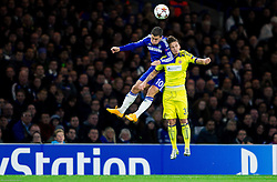 Eden Hazard of Chelsea vs Petar Stojanovic of Maribor during football match between Chelsea FC and NK Maribor, SLO in Group G of Group Stage of UEFA Champions League 2014/15, on October 21, 2014 in Stamford Bridge Stadium, London, Great Britain. Photo by Vid Ponikvar / Sportida.com