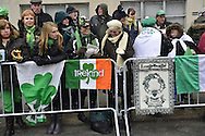 March 16, 2013 - New York, NY, U.S. - At the 252nd annual NYC St. Patrick's Day Parade, thousands of marchers show their Irish pride, as they march up Fifth Avenue, and over a million people, often in green and orange, watch and celebrate. The snow that begaan to fall in Manhattan after the parade started didn't stop the celebrations.