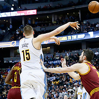 22 March 2017: Denver Nuggets forward Nikola Jokic (15) passes the ball over Cleveland Cavaliers forward Kevin Love (0) during the Denver Nuggets 126-113 victory over the Cleveland Cavaliers, at the Pepsi Center, Denver, Colorado, USA.
