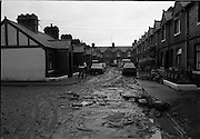 """Flooding at the Dodder..1986..26.08.1986..08.26.1986..28th August 1986..As a result of Hurricane Charly (Charlie) heavy overnight rainfall was the cause of severe flooding in the Donnybrook/Ballsbridge areas of Dublin. In a period of just 12 hours it was stated that 8 inches of rain had fallen. The Dodder,long regarded as a """"Flashy"""" river, burst its banks and caused great hardship to families in the 300 or so homes which were flooded. Council workers and the Fire Brigades did their best to try and alleviate some of the problems by removing debris and pumping out some of the homes affected..Note: """"Flashy"""" is a term given to a river which is prone to flooding as a result of heavy or sustained rainfall...The aftermath,when the water receded a sea of mud was left behind on the streets,but worst of all in peoples' homes as well."""