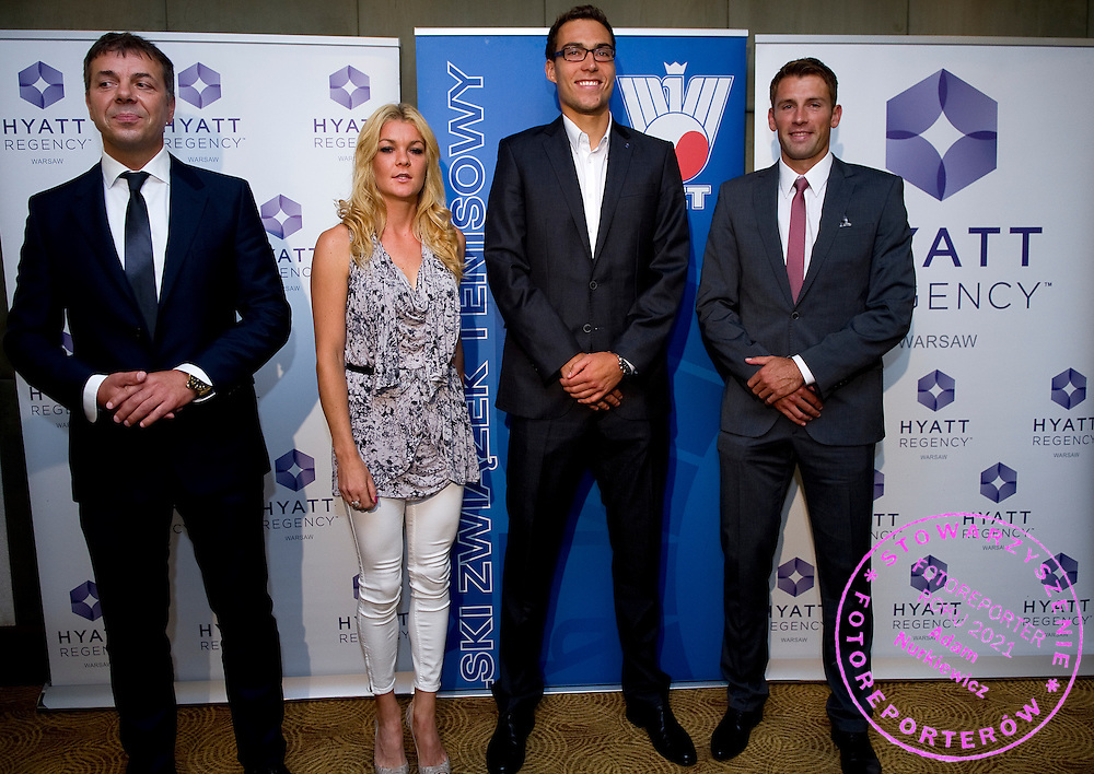 (L-R) Krzysztof Suski - President of Polish Tennis Association and Agnieszka Radwanska and Jerzy Janowicz and Lukasz Kubot during press conference of Polish Tennis Association at Hyatt Hotel in Warsaw, Poland.<br /> <br /> Poland, Warsaw, July 08, 2013<br /> <br /> Picture also available in RAW (NEF) or TIFF format on special request.<br /> <br /> For editorial use only. Any commercial or promotional use requires permission.<br /> <br /> Photo by &copy; Adam Nurkiewicz / Mediasport