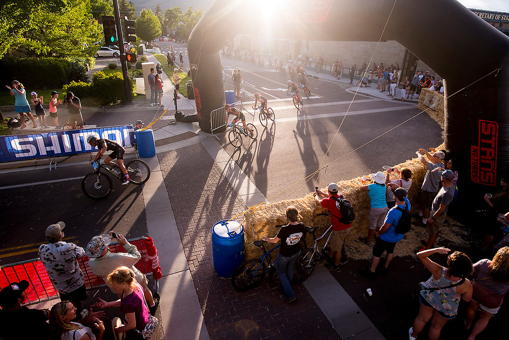 The Pro Men round a corner during the Fat Tire Crit on Friday.