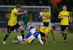 Bristol Rovers' Eliot Richards is tackled by Burton Albion's Shane Cansdell-Sherriff-- Photo mandatory by-line: Matt Bunn/JMP - Tel: Mobile: 07966 386802 23/11/2013 - SPORT - Football - Burton - Pirelli Stadium - Burton Albion v Bristol Rovers - Sky Bet League Two