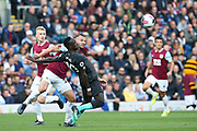 Liverpool forward Sadio Mane (10) fends off the challenge from Burnley defender Erik Pieters (23)  during the Premier League match between Burnley and Liverpool at Turf Moor, Burnley, England on 31 August 2019.