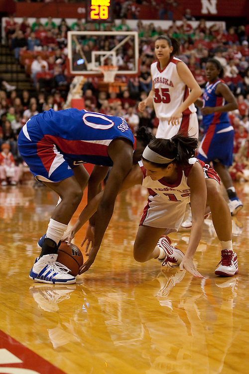 03 March 2010: Nebraska's Layne Reeves (12) gets the jumpball against Kansas' LaChelda Jacobs (00) at the Bob Devaney Sports Center in Lincoln, Nebraska. Nebraska defeated Kansas 77 to 52.