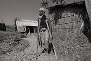 Kurigrame 2006- Old age village stand in front of his house- Copyright Monirul Alam