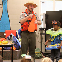 Adam Robison | BUT AT PHOTOS.DJOURNAL.COM<br /> Park Ranger Chris Gurner has Christian Bass, a kindergartener at Saltillo Primary School, help him demonstrate which items are necessary to have while spending time in the water during water saftey day at Saltillo Primary School Wednesday morning. The Rangers demonstrated different water safety techniques during beach bum day at the school.
