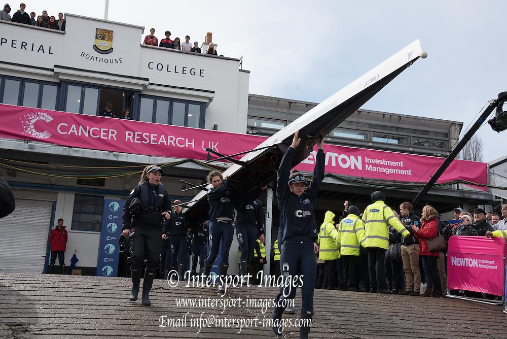 London. UNITED KINGDOM.  162nd BNY OUWBC, carry their boat out  The 71st Newton Women's Boat Race on the Championship Course, River Thames, Putney/Mortlake.  Sunday  27/03/2016    [Mandatory Credit. Intersport Images]<br /> <br /> Oxford University Women's Boat Club {OUWBC} vs Cambridge University Women's Boat Club {CUWBC} <br /> <br /> Oxford, Crew Cox &ndash; Morgan Baynham-Williams, Stroke &ndash; Lauren Kedar, 7 &ndash; Maddy Badcott, 6 &ndash; Anastasia Chitty, 5 &ndash; Elo Luik, 4 &ndash; Ruth Siddorn, 3 &ndash; Joanneke Jansen, 2 &ndash; Emma Spruce, Bow &ndash; Emma Lukasiewicz