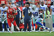 KANSAS CITY, MO - SEPTEMBER 15:  Wide receiver Dez Bryant #88 of the Dallas Cowboys rushes past strong safety Quintin Demps #35 of the Kansas City Chiefs for a first down during the first half on September 15, 2013 at Arrowhead Stadium in Kansas City, Missouri.  (Photo by Peter Aiken/Getty Images) *** Local Caption *** Dez Bryant;Quintin Demps