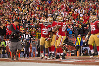 12 January 2013: Runningback (21) Frank Gore of the San Francisco 49ers runs the ball, scores a touchdown, and celebrates with his teammates against the Green Bay Packers during the second half of the 49ers 45-31 victory over the Packers in an NFL Divisional Playoff Game at Candlestick Park in San Francisco, CA.