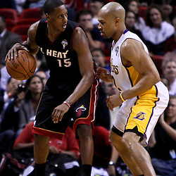 March 10, 2011; Miami, FL, USA; Miami Heat point guard Mario Chalmers (15) is guarded by Los Angeles Lakers point guard Derek Fisher (2) during the first quarter at the American Airlines Arena.  Mandatory Credit: Derick E. Hingle