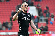 Luke Ayling (2) of Leeds United punches the air in celebration in front of the Leeds fans at full time after the 3-0 win during the EFL Sky Bet Championship match between Bristol City and Leeds United at Ashton Gate, Bristol, England on 21 October 2017. Photo by Graham Hunt.