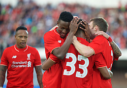 HELSINKI, FINLAND - Friday, July 31, 2015: Liverpool's Divock Origi celebrates scoring the first goal against HJK Helsinki during a friendly match at the Olympic Stadium. (Pic by David Rawcliffe/Propaganda)
