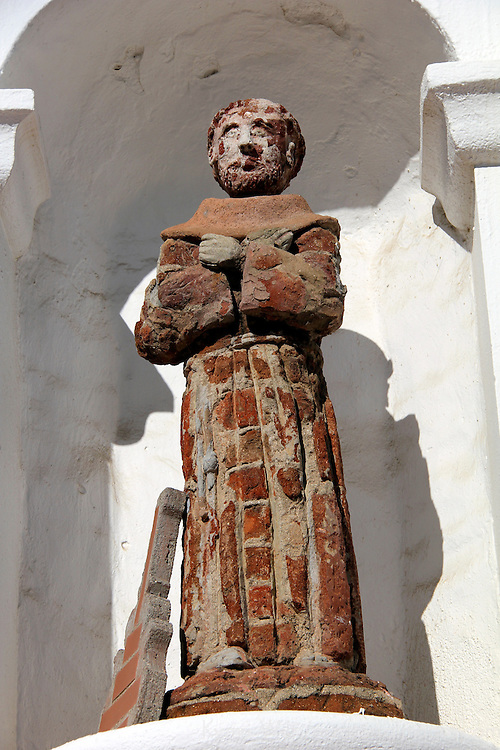 USA, California, Oceanside. Brick statue of saint at Old Mission San Luis Rey de Francia.