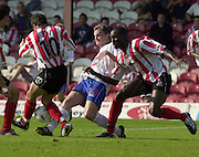 Nationwide Div 2 - Brentford v Hartlepool..Pool's Paul Robinson find's himself surrounded by the bee's defence.© Peter Spurrier/Intersport-Images, email images@intersport-images.com. Mob +447973819551